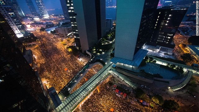 Protesters take part in a rally on a street outside of Hong Kong Government Complex on September 30, 2014 in Hong Kong.