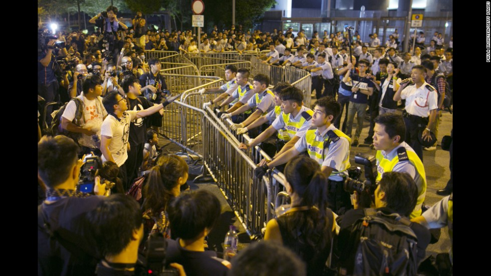 Protesters confront police outside the government complex in Hong Kong on October 2.