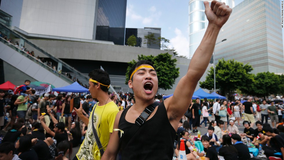 A pro-democracy activist shouts slogans on a street near the government headquarters on Wednesday, October 1.