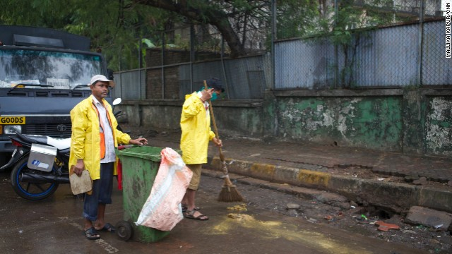 Ganesh Shinde (right) with his colleague doing their job on the streets of Mumbai.