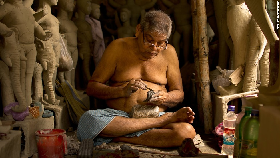 "An artisan creates <a href=""http://ireport.cnn.com/docs/DOC-1027924"">traditional statues</a> of Hindu gods and goddesses in Kolkata, India. One idol takes 10 to 15 days to be completed."