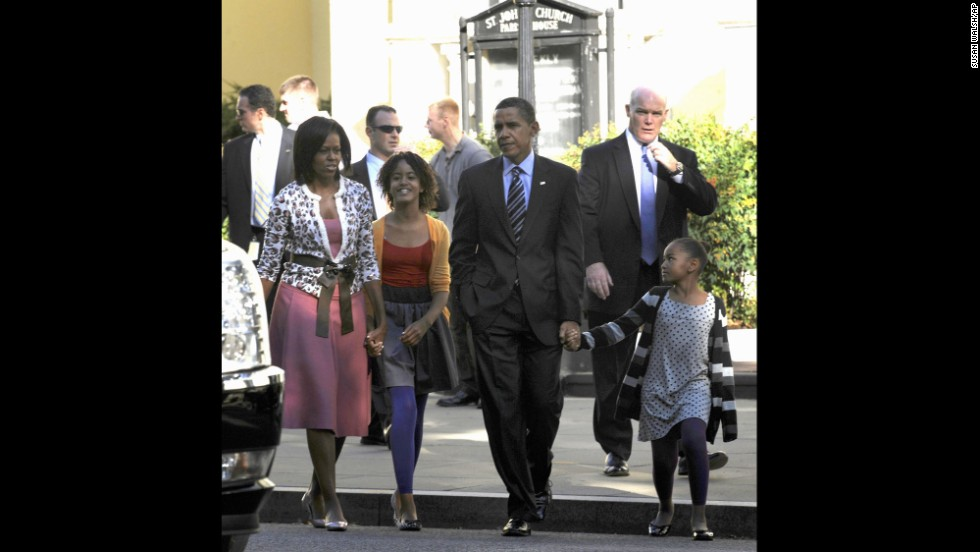 Clancy, right, walks with the first family after they attended church in October 2009.