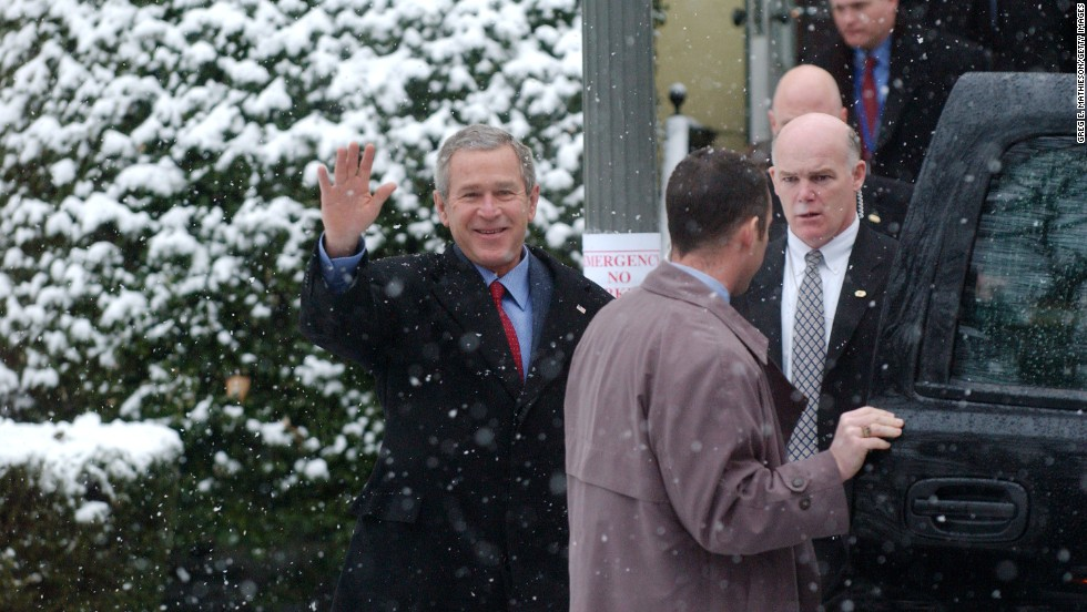 Clancy follows Bush at a Washington church in January 2005.