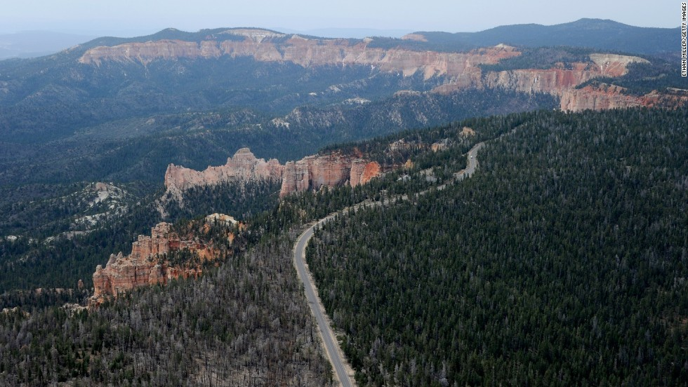 One of the most spectacular drives in the American West, Highway 12 in southern Utah passes two national parks, a national monument and a wide variety of scenery, including red-rock canyons and forested plateaus. This is an aerial view of Bryce Canyon National Park, famous for its rocky spires in pastel shades of red, pink and orange.