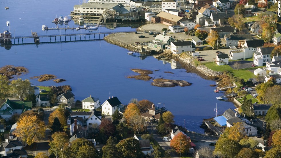 Visitors to Boothbay Harbor on Maine's central coast can browse art galleries, take a whale-watching tour or admire the views from a wooden footbridge, seen in the upper part of this photo.