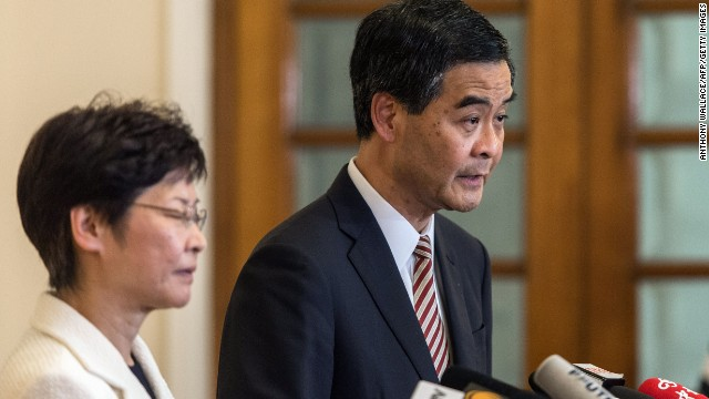 Hong Kong's embattled leader, Chief Executive Leung Chun-ying (R) and Chief Secretary Carrie Lam hold a press conference at Leung's official residence in Hong Kong on October 2, 2014, just minutes before a midnight deadline set by protesters demanding his resignation expired.