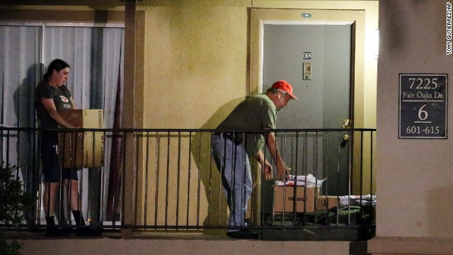 Red Cross representatives drop off blankets, cots and other supplies in front of a unit at The Ivy Apartments, Thursday, Oct. 2, 2014, in Dallas. Dallas city officials asked a family who resides at the complex who had contact with a man diagnosed with the Ebola virus to remain in their home. (AP Photo/Tony Gutierrez)