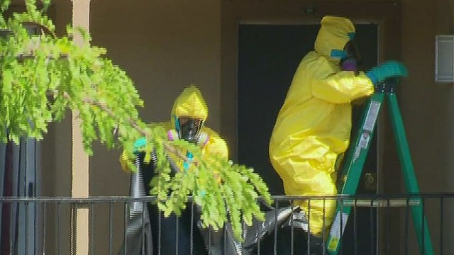 Hazmat team cleans quarantined apartment
