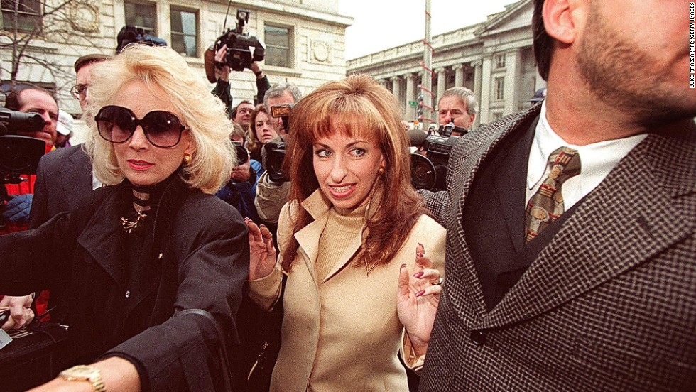 "Paula Jones, center, arrives at the office of a lawyer representing President Clinton in Washington on January 17, 1998. The former Arkansas state employee filed a federal civil lawsuit in 1994 accusing Clinton of making ""persistent and continuous"" unwanted sexual advances during a conference in 1991, when he was governor. The President agreed to an $850,000 settlement on November 13, 1998."