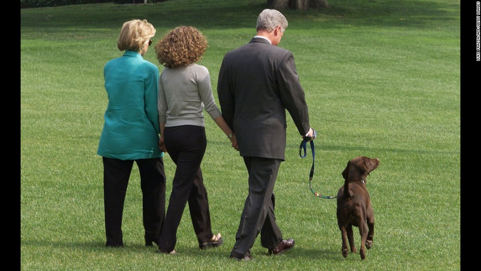 The Clintons, and their daughter Chelsea, center, depart the White House on August 18, 1998, with their dog Buddy on their way to a two-week vacation in Martha's Vineyard, Massachusetts. Clinton gave a televised address a day before to the American people from the White House regarding his testimony earlier to a federal grand jury in which he admitted to an inappropriate relationship with Monica Lewinsky.