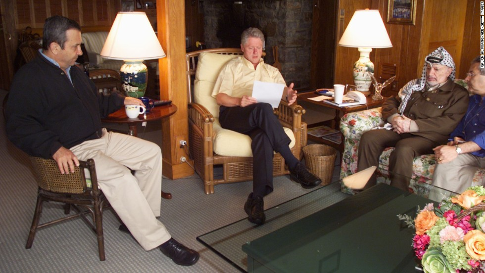 Clinton meets with Israeli Prime Minister Ehud Barak, left and Palestinian Authority Chairman Yasser Arafat on July 25, 2000, at Camp David at the end of a Mideast peace summit. The talks ended without an agreement.