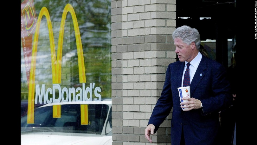 Clinton leaves McDonald's after stopping for a crispy chicken sandwich, fries and a large Diet Coke following his passing of the symbolic torch as the leader of the Democratic Party to vice president and Democratic presidential candidate Gore in Monroe, Michigan, on August 15, 2000.