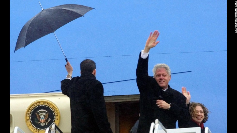 Clinton and daughter Chelsea wave before boarding his plane at Andrews Air Force Base as he leaves Washington following Bush's inauguration on January 20, 2001. Clinton was heading to his new home in Chappaqua, New York.