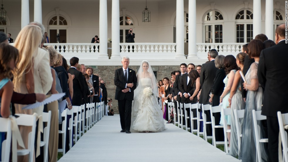 The former President walks his daughter Chelsea down the aisle during her wedding to Marc Mezvinsky at the Astor Courts Estate in Rhinebeck, New York, on July 31, 2010.