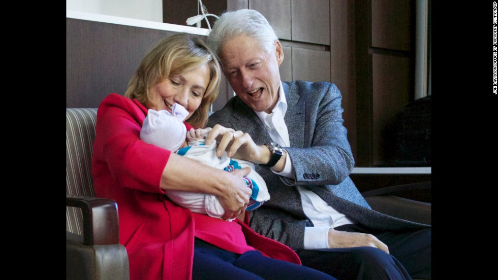 Hillary and Bill Clinton hold their granddaughter in September at Lenox Hill Hospital in New York. Charlotte Clinton Mezvinsky is the first child of their daughter, Chelsea.