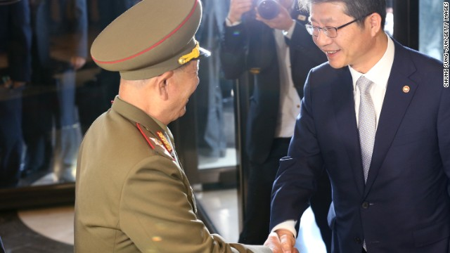 Caption:INCHEON, SOUTH KOREA - OCTOBER 04: South Korean unification minister Ryoo Kihl-Jae (R) shakes hands with Hwang Pyong-So (L) vice chairman of North Korea's National Defense Commission on October 4, 2014 in Incheon, South Korea. The North Korean delegation, including Hwang Pyong-So, who is thought to be the country's No.2 after Kim Jong-Un, made a surprise visit to South Korea to attend the closing ceremony of the Asian Games. (Photo by Chung Sung-Jun/Getty Images)