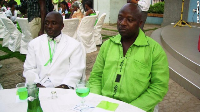 This 2011 photo provided by Wilmot Chayee shows Thomas Eric Duncan, right, with friend Wilmot Chayee at a wedding in Ghana. Duncan, who became the first patient diagnosed in the U.S with Ebola, has been kept in isolation at a hospital since Sunday, Sept. 28, 2014. He was listed in serious but stable condition. (AP Photo/Wilmot Chayee)