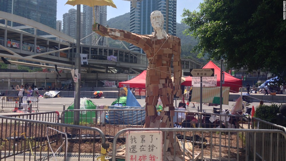 "The statue ""Umbrella Man,"" by the Hong Kong artist known as Milk, stands at a pro-democracy protest site in the Admiralty district on October 6."