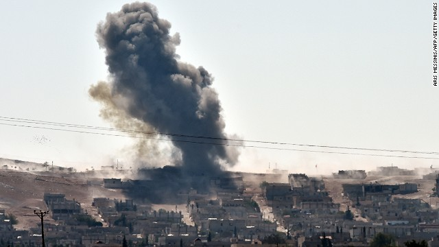 Smoke rises from the Syrian town of Ain al-Arab, known as Kobani by the Kurds, on the Turkish-Syrian border in the southeastern town of Suruc, Sanliurfa province, on October 6, 2014.