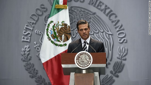 Mexican President Enrique Pena Nieto delivers a speech at the National Palace, in Mexico City, on October 6, 2014. ena Nieto vowed Monday that authorities would go after those behind the disappearance of 43 students amid fears several of them were among bodies in a mass grave.AFP PHOTO/RONALDO SCHEMIDT (Photo credit should read RONALDO SCHEMIDT/AFP/Getty Images)