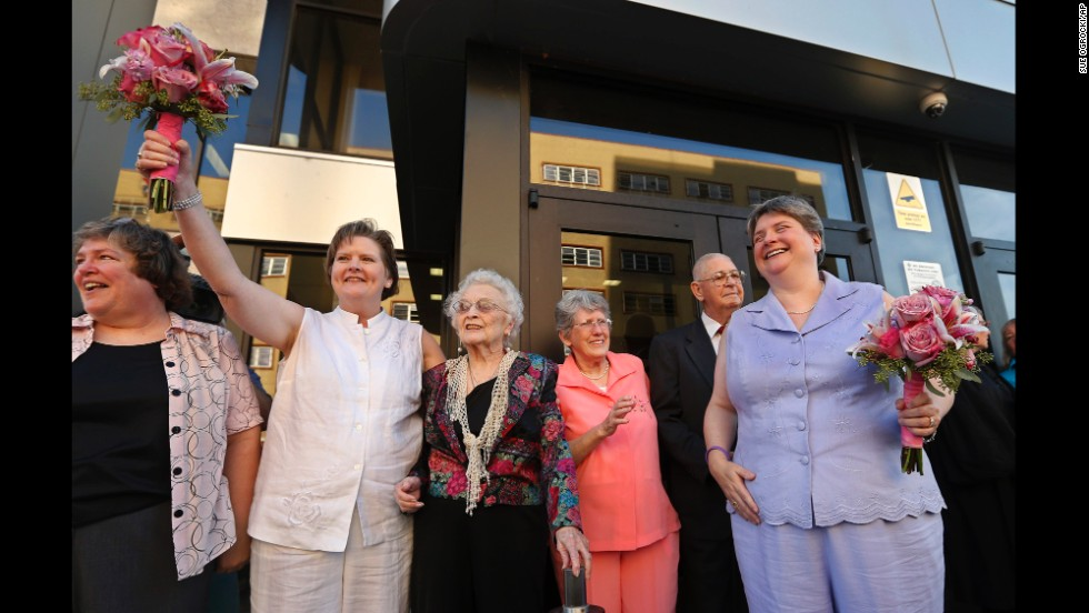 Mary Bishop, second from left, and Sharon Baldwin, right, celebrate with family and friends following their wedding ceremony on the courthouse steps in Tulsa, Oklahoma, on October 6, 2014.