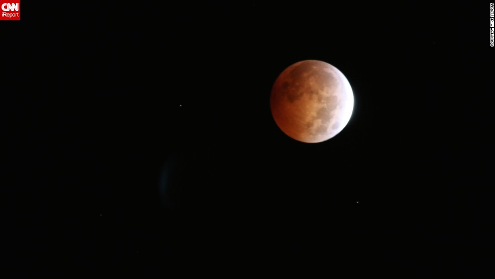 "<a href=""http://ireport.cnn.com/docs/DOC-1177346"">Mike Escott</a> was up at 3 a.m. to photograph the blood moon from his home in San Francisco. He was inspired to set his alarm clock early and head up to his roof to document the lunar event."