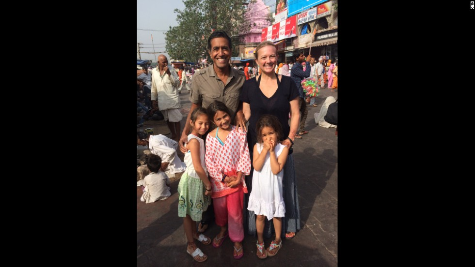 "Gupta, his wife and his three daughters pose for a photo in Haridwar, India. ""The whole family took a bath in the Ganges River, one of the holiest rivers in the world,"" Gupta said. ""When I explained to my three daughters that it helped purge us of our sins, they suggested that I should've stayed in the river longer!"""