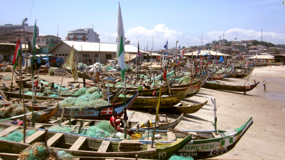 Small fishing boats line Elmina Beach in Cape Coast, Ghana. Two centuries ago, slave ships lined this same beach as they prepared for a long journey across the Atlantic.