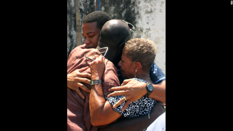 Lemon and his mother, Katherine, share a hug with historian Essel Blankson, who had just welcomed them to Africa. They then entered the slave fort at Cape Coast Castle, reversing the path that thousands of Ghanians took on their journey into slavery.