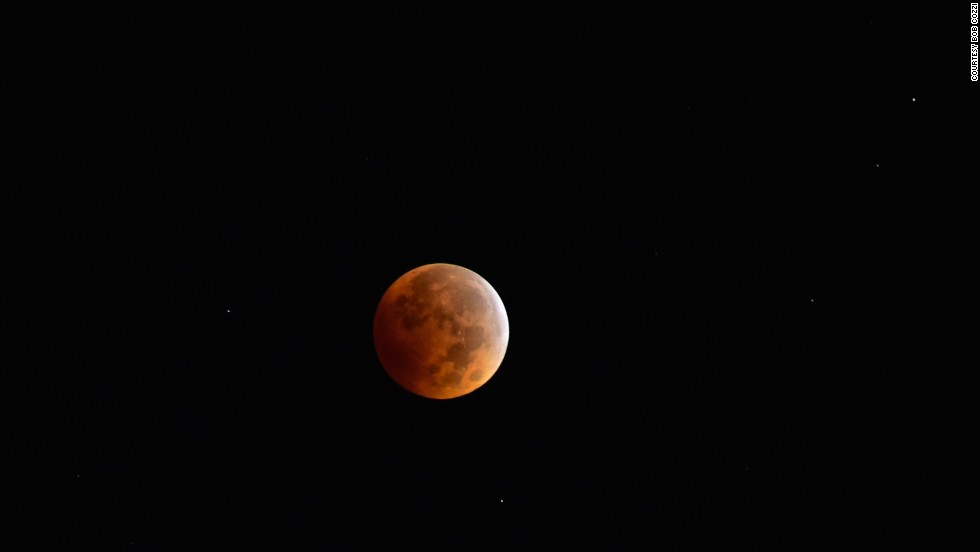 "<a href=""http://ireport.cnn.com/docs/DOC-1177241"">Bob Cozzi</a> got up early to see the blood moon over North Aurora, Illinois, at 6 a.m. on Wednesday. ""With the clear sky, it feels like you're on another planet,"" Cozzi said."