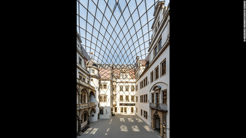 The inner courtyard of Dresden Castle is sheltered by a curved lattice glass roof designed by local architect Peter Kulka.