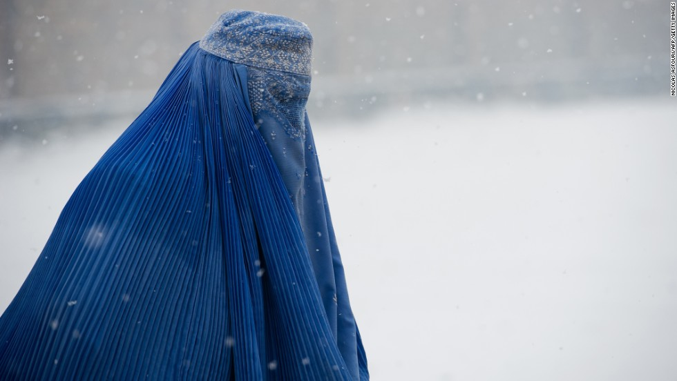 The burqa covers a woman from head to toe in a loose veil. It covers the face completely and has a mesh section over the eyes that allows the wearer to see. It is widely worn in Afghanistan.