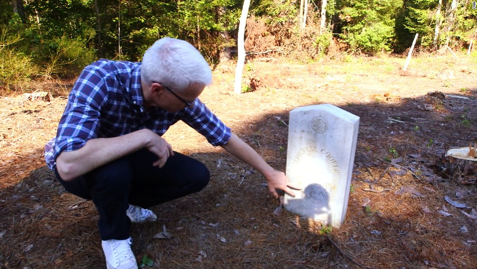 Cooper visits the grave site of Burrell C. Cooper, his great-great-grandfather who fought as a Confederate soldier in the Civil War.