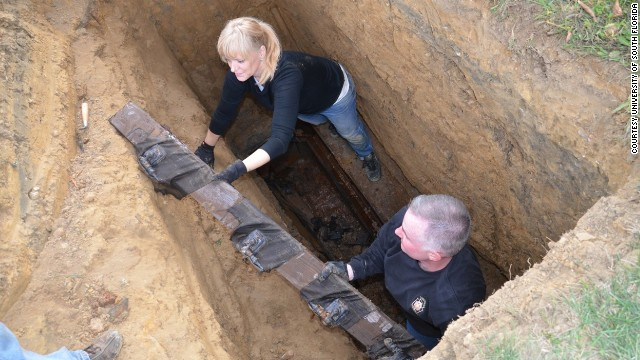 After their investigation at a former Florida boys school led them to a grave in Philadelphia, anthrpologist Erin Kimmerle and Cpl. Tom McAndrew of the Pennsylvania State Police unearth a casket filled with wood. It was supposed to contain Thomas Curry.