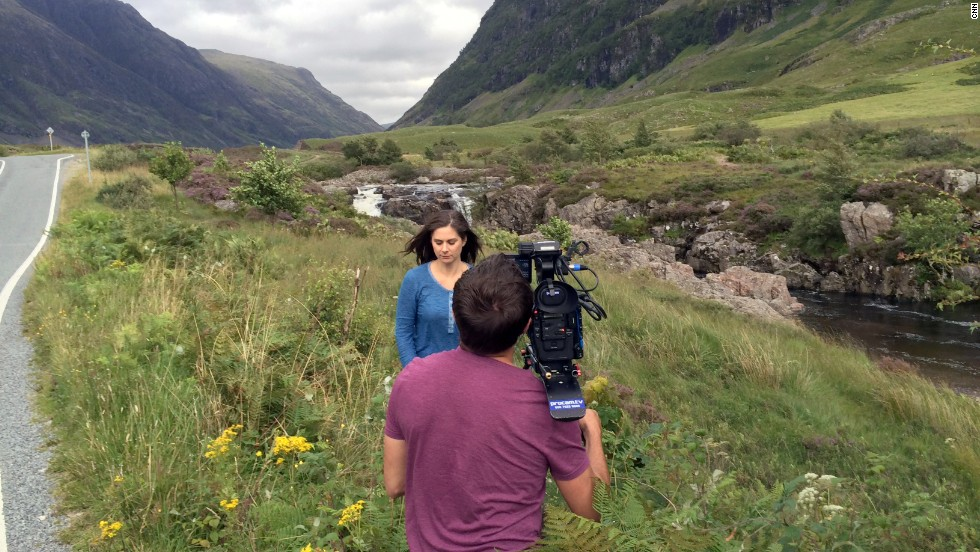Burnett shoots a segment among the rolling hills in the Isle of Skye.