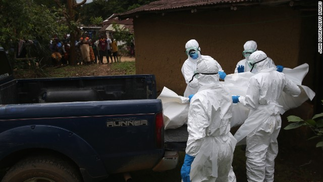 A burial team from the Liberian Red Cross carries the body of an Ebola victim from his home on October 8, 2014 near Monrovia, Liberia. The Ebola epidemic has killed more than 3,400 people in West Africa, according to the World Health Organization.