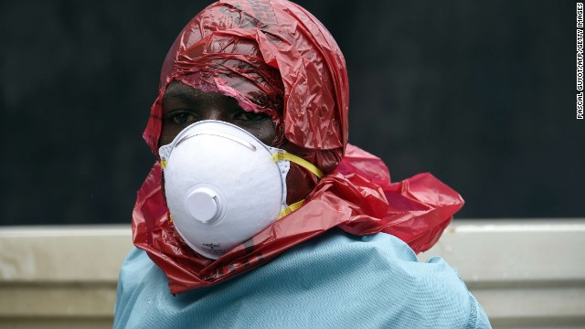 A Red Cross member of staff looks on after collecting the corpse of a female victim of the Ebola virus from her home, in Monrovia, on September 29, 2014. Of the four west African nations affected by the Ebola outbreak, Liberia has been hit the hardest, with 3,458 people infected -- more than half of the total number of cases. Of those, 1,830 have died, according to a WHO count released on September 27.