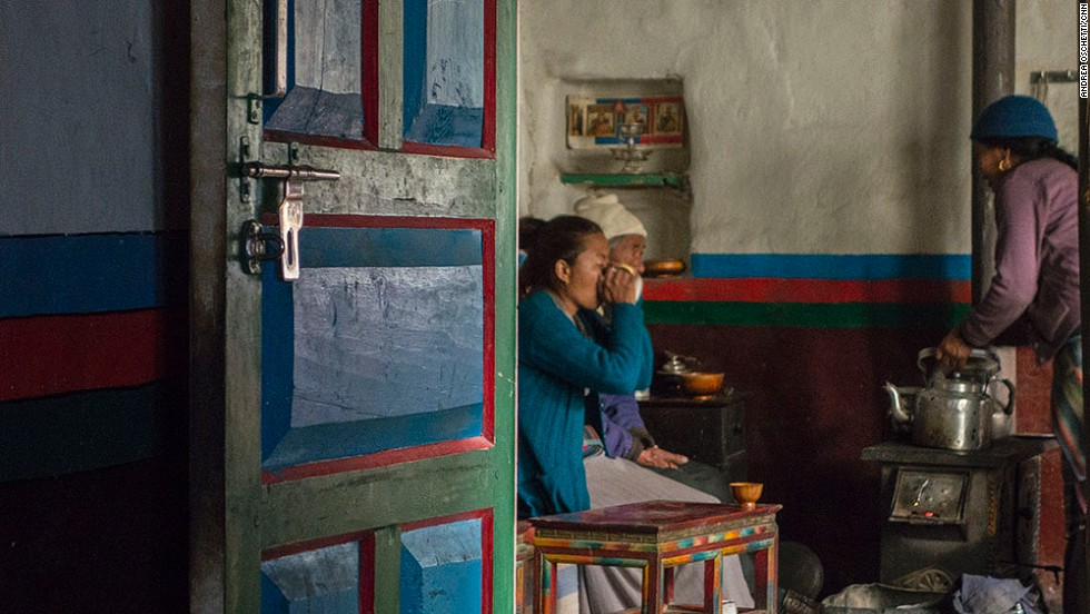 Staying in a local home is a meaningful way to generate cultural exchange out of brief encounters. Dikee Dolker Gurung, 30, and her parents Angjuk Gurung, 71, and Tsering Pajung Gurung, 62, eat breakfast around the stove.