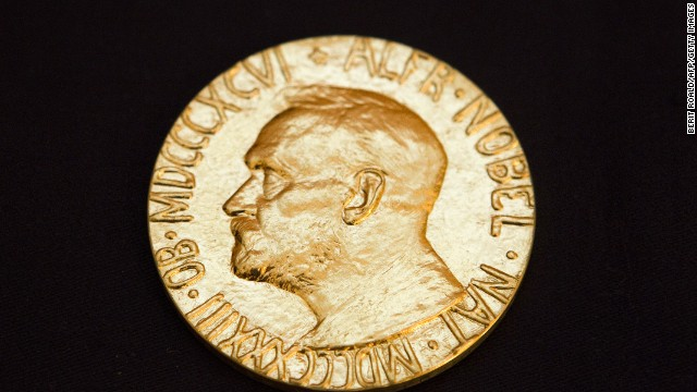 Caption:This picture taken on December 10, 2010 shows the front of the Nobel medal awarded to the Nobel Peace Prize laureate for 2010, jailed Chinese dissident Liu Xiabo. The Nobel Peace Prize ceremony began in Oslo Friday without guest of honour Liu Xiaobo, a jailed Chinese dissident who was represented by an empty chair at the event. Other Chinese dissidents, ambassadors from a number of countries, Norway's king and queen and other dignitaries were present as the ceremony opened in a flower-decked Oslo city hall. AFP PHOTO / SCANPIX - Berit Roald (Photo credit should read BERIT ROALD/AFP/Getty Images)
