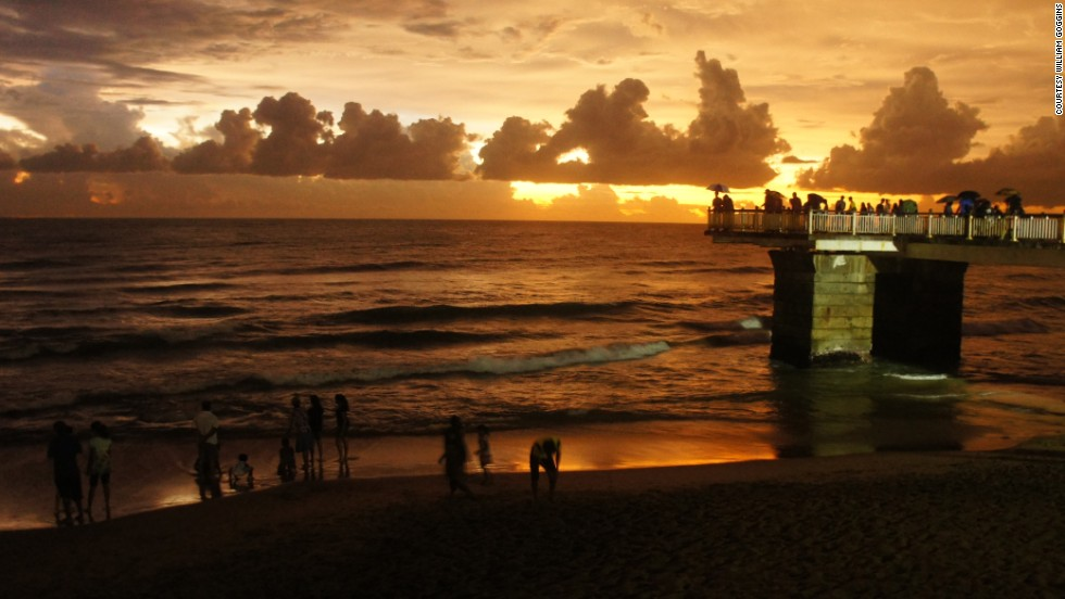 "A warm sunset settles over the Galle Face Green promenade in the business district of <a href=""http://ireport.cnn.com/docs/DOC-1099937"">Colombo, Sri Lanka</a>. The ocean-side urban park is a popular destination for residents and tourists."
