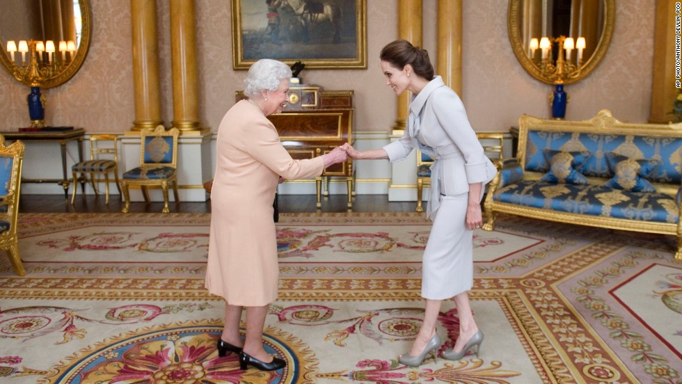 OCTOBER 10 - LONDON, UK: Actress Angelina Jolie is presented with the insignia of an Honorary Dame Grand Cross of the Most Distinguished Order of St Michael and St George by Queen Elizabeth II. Jolie received the honorary damehood for services to UK foreign policy and the campaign to end war zone sexual violence.