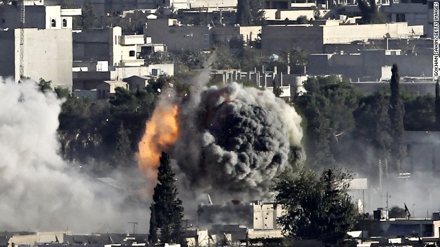 Heavy smoke rises from a fire caused by a strike in Kobani, Syria, as fighting intensified against ISIS militants on Friday.