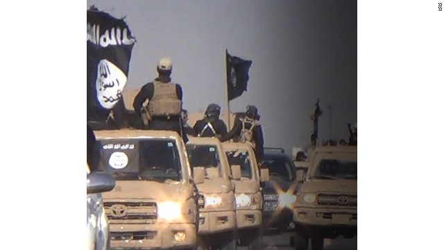 : 	Images of an ISIS parade in the Kirkuk Province
