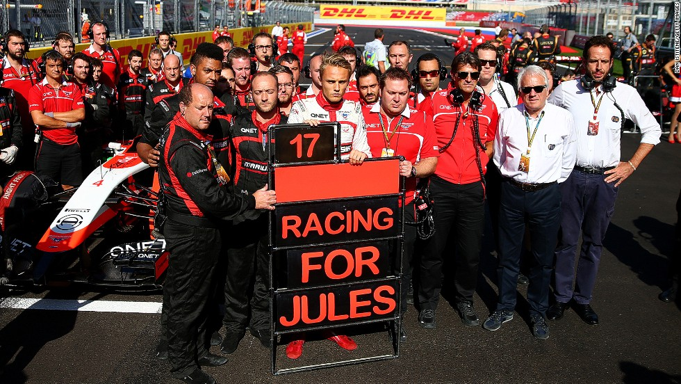Marussia has not just been troubled by financial problems this season, with the team left devastated after French driver Jules Bianchi crashed and suffered critical head injuries at the Japanese Grand Prix. Here Chilton stands with his team next to a tribute to Bianchi and Marussia following his accident at Suzuka during the Russian Grand Prix at Sochi in October.