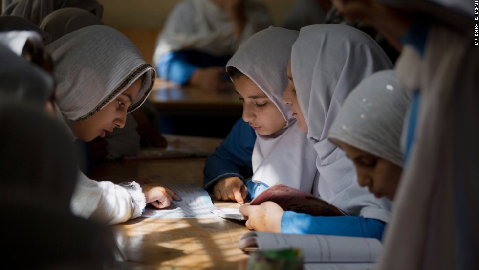 "OCTOBER 13 - SWAT, PAKISTAN: Pupils study at a school in the conservative hometown of Taliban attack survivor Malala Yousafzai.  <a href=""http://edition.cnn.com/2014/10/10/world/europe/nobel-peace-prize/index.html?hpt=hp_t4"">Malala and Kailash Satyarthi of India </a>have jointly been awarded the Nobel Peace Prize, for risking their lives to fight for children's rights."