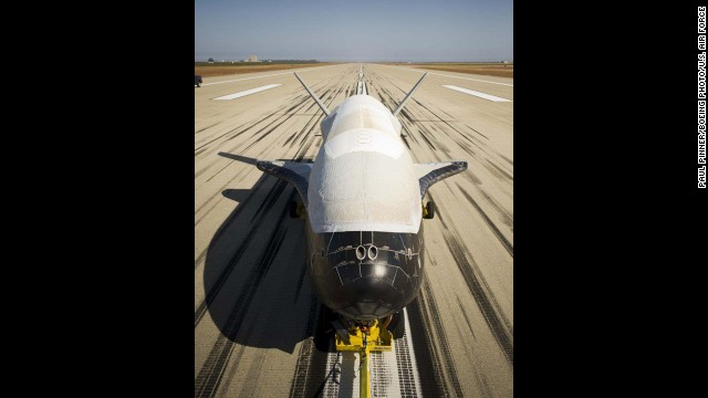 The X-37B Orbital Test Vehicle, the Air Force's unmanned, reusable space plane, landed at Vandenberg Air Force Base, Calif., June 16, 2012. OTV-2, which launched from Cape Canaveral Air Force Station, Fla., March 5, 2011, conducted on-orbit experiments for 469 days during its mission. (Boeing photo/ Paul Pinner)