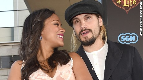 "Zoe Saldana and husband Marco Perego share an affectionate moment on the red carpet of Saldana's new movie, ""The Book of Life."""