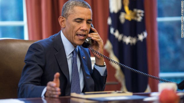 President Barack Obama talks on the phone with Dr. Tom Frieden, Director of the Centers for Disease Control and Prevention, in the Oval Office, Sept. 30, 2014.