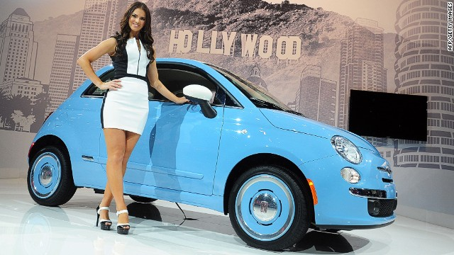 A spokesmodel poses beside the 2014 Fiat 500 1957, displayed on November 21, 2013 at the LA Auto Show in Los Angeles, California, which opens to the public from November 22 to December 1. AFP PHOTO/Frederic J. BROWNFREDERIC J. BROWN/AFP/Getty Images