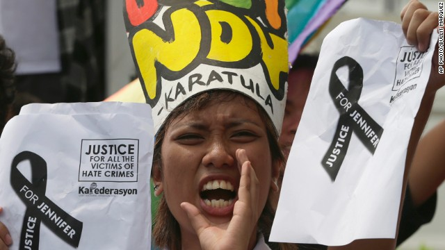 A protest takes place on October 14, 2014. at the U.S. Embassy in Manila, Philippines, against the killing of a transgender.